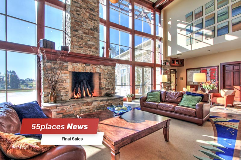 """55places News: Final Sales"" banner over the fireplace lounge in the clubhouse at Trilogy at Rio Vista in Rio Vista, California"