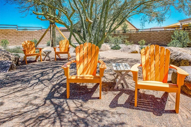 Wooden lounge chairs in an outdoor space at Trilogy At Vistancia in Peoria, Arizona