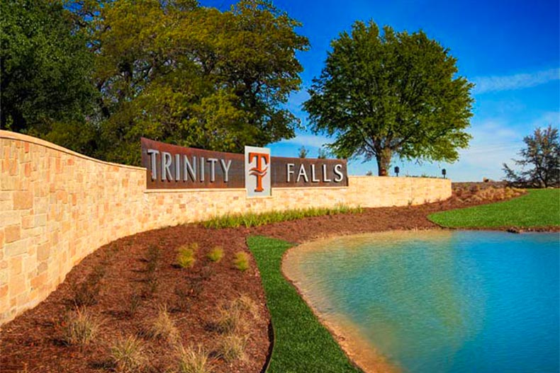 Trinity Falls entrance sign near a pond near Dallas