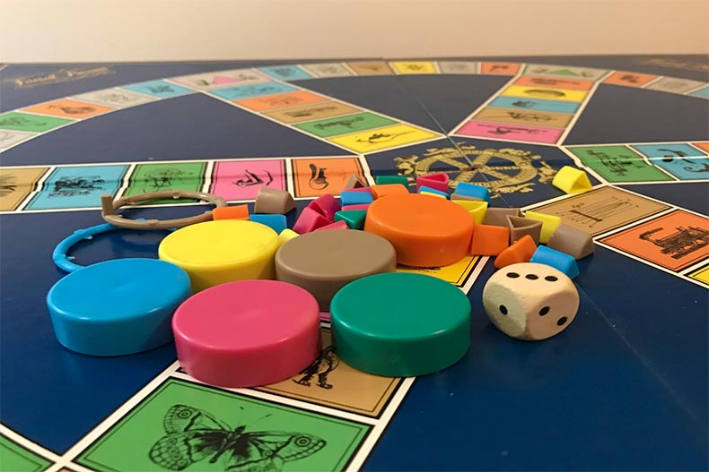 Close up of a Trivial Pursuit board and pieces
