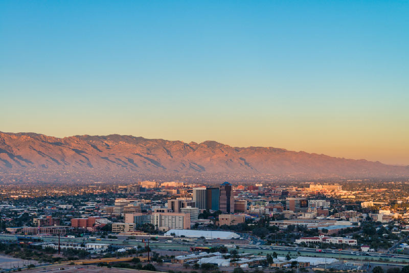 aerial skyline of tucson with mountains in distance