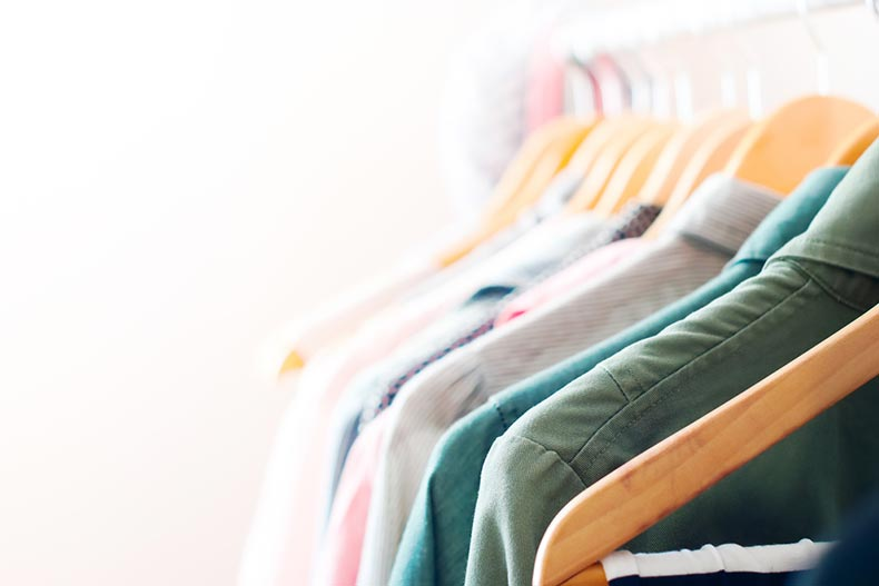 Pastel colored women's clothing hanging on a rack