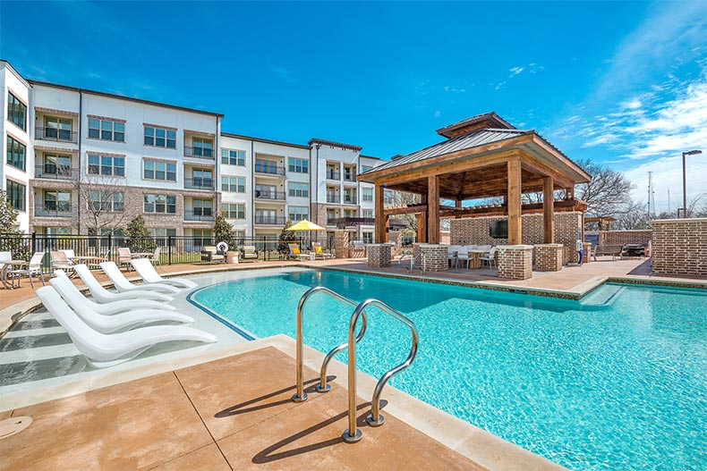 Blue sky over the outdoor pool and patio at Overture Flower Mound in Flower Mound, Texas