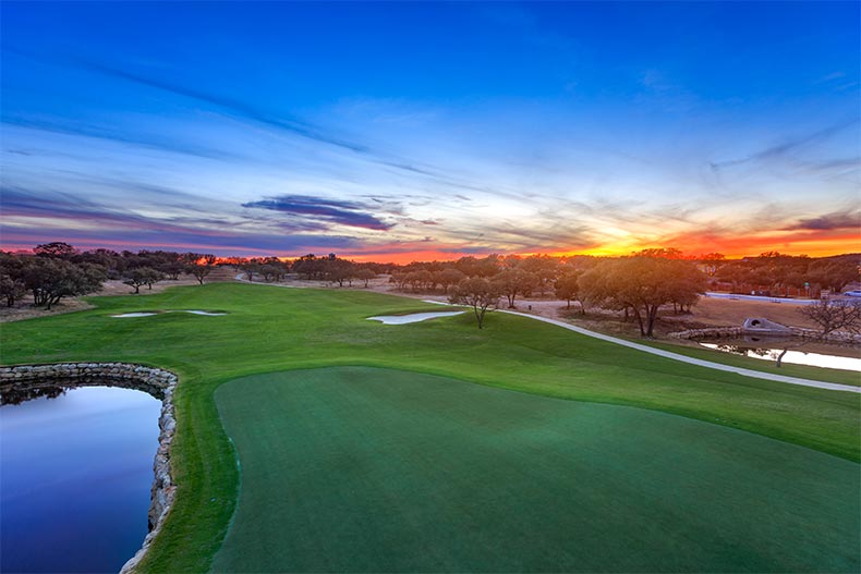 Sunset view of the golf course at Kissing Tree in San Marcos, Texas
