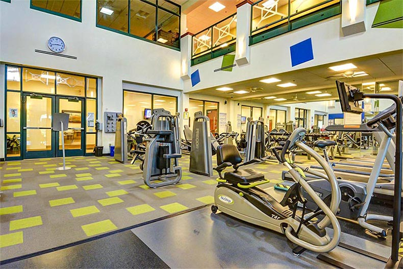 Interior view of the fitness center at Frisco Lakes in Frisco, Texas