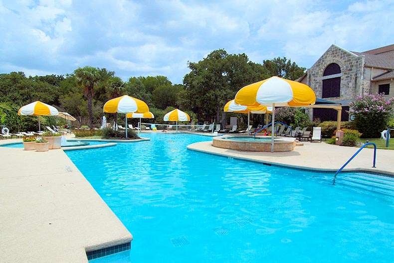 View of the outdoor pool and patio at Sun City Texas in Georgetown, Texas