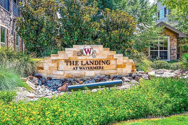 Blooming greenery around the community sign for Watermere at Southlake in Southlake, Texas