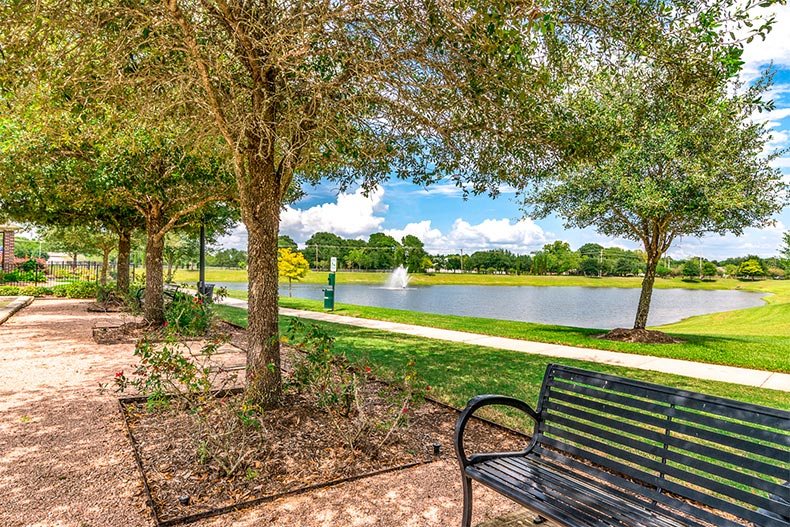 View of a pond surrounded by greenspace on the grounds Tuscan Village in Lakeway, Texas