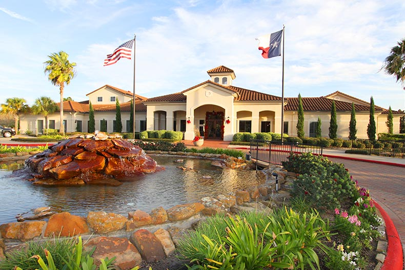 View of the water feature and landscaping outside the clubhouse at Bellavita at Green Tee in Pearland, Texas