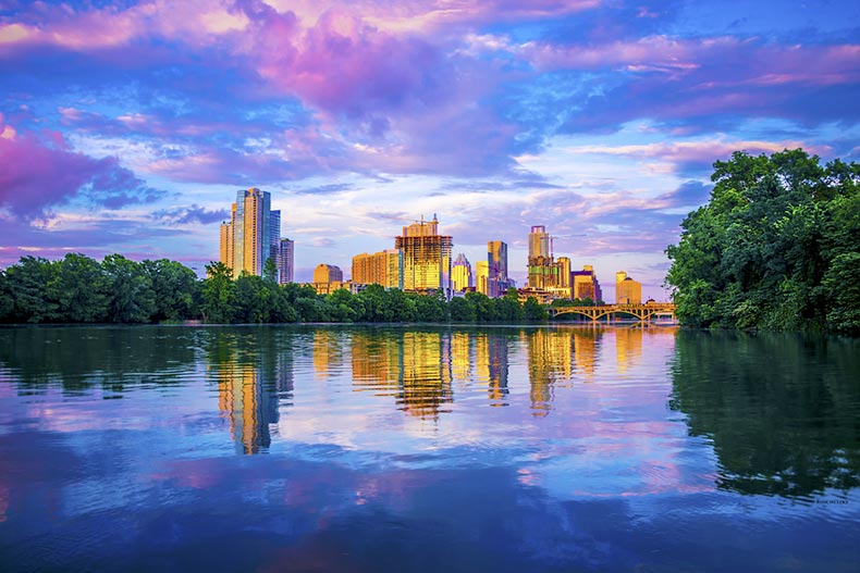 Sunset view of the Austin, Texas skyline from Lou Neff Point across a lake
