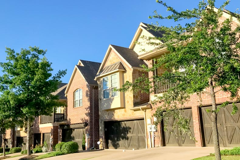 Blue sky over a row of new attached townhomes outside Dallas, Texas