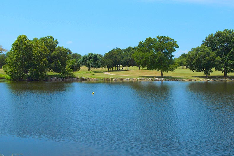 A blue sky over Berry Creek Pond at Sun City Texas in Georgetown, Texas