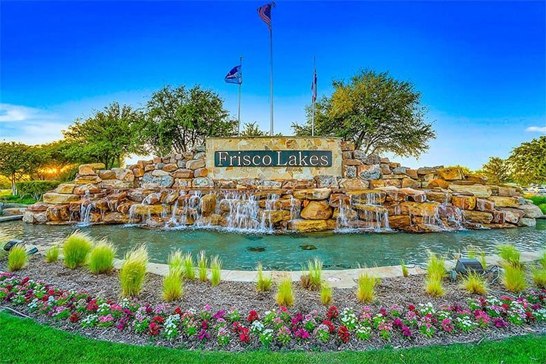 View of the community sign and water feature at Frisco Lakes in Frisco, Texas