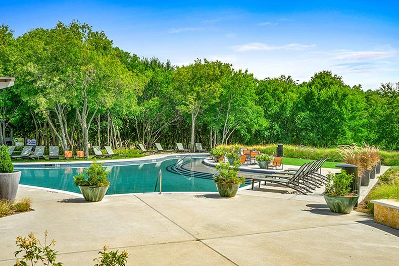 An outdoor pool and patio at Del Webb at Union Park in Little Elm, Texas