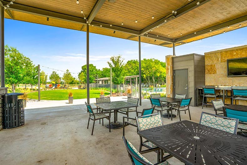 A covered outdoor dining area at Del Webb at Union Park in Little Elm, Texas