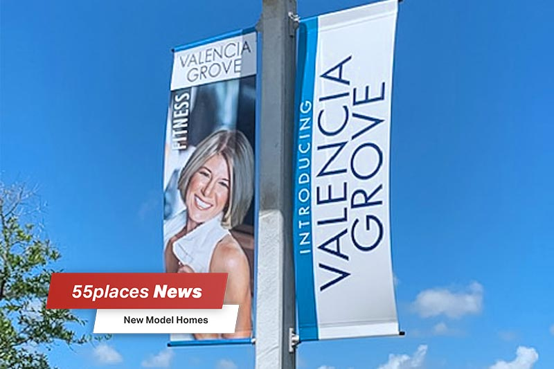 """New Model Homes"" banner over a pole with a promotional banner for Valencia Grove at Riverland in Port St Lucie, Florida"