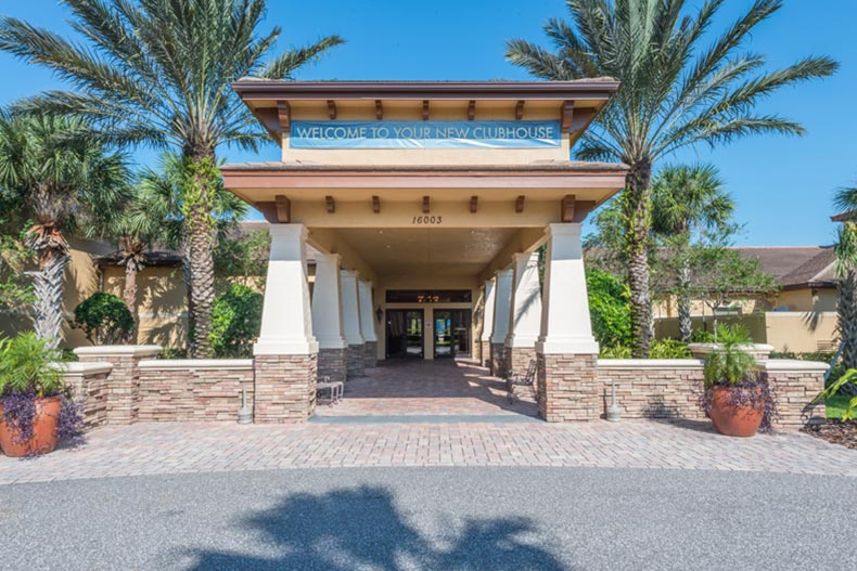 Exterior view of the clubhouse entrance at Valencia Lakes in Wimauma, Florida