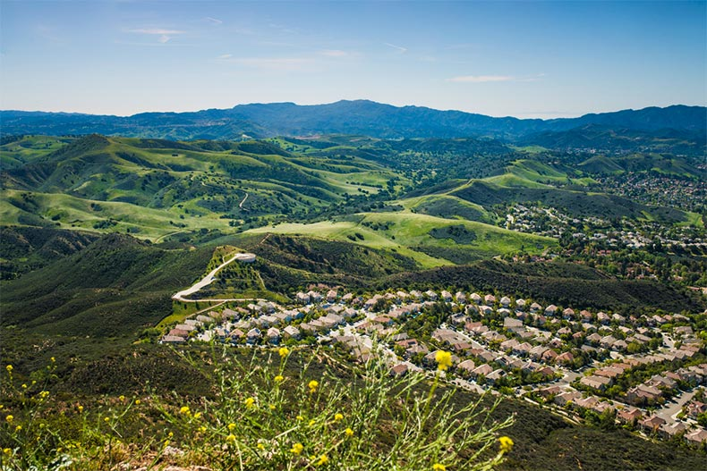 View of Thousand Oaks, California from a peak. Rolling hills and mountains in the background