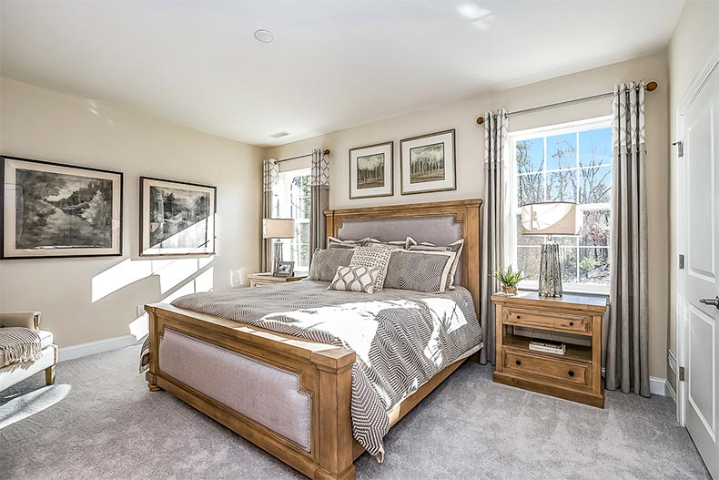 Interior view of a bedroom in a model home at Venue at Smithville Greene in Eastampton, New Jersey