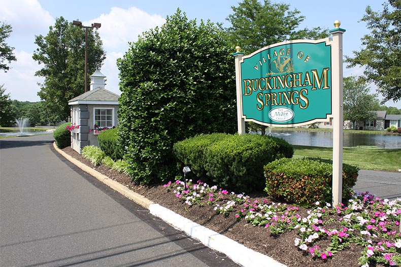 The community sign and entrance to Village of Buckingham Springs in New Hope, Pennsylvania