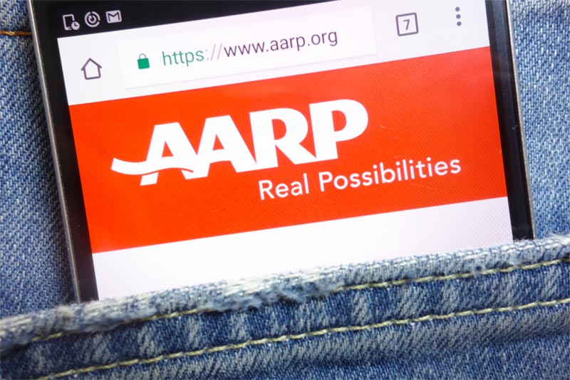 phone in pocket with aARP website pulled up