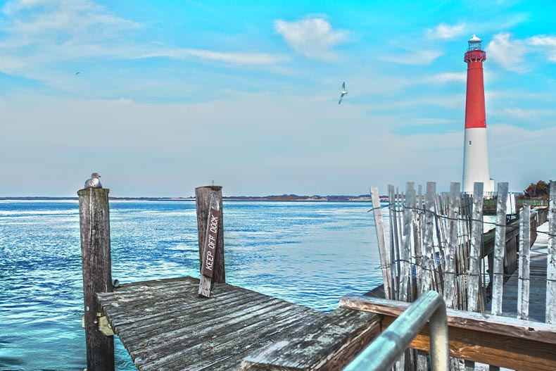 Photo of a dock and red lighthouse on the Atlantic Coast in Ocean County, New Jersey