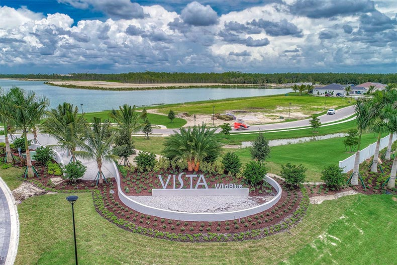 Aerial view of the community sign and entrance to WildBlue in Estero, Florida