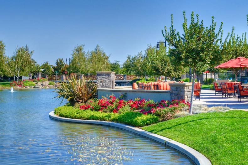 A scenic pond and outdoor patio at Woodbridge in Manteca, California
