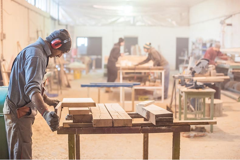 Group of people working in a woodworking shop