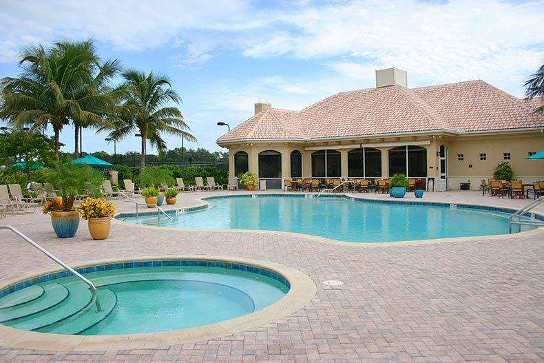 The outdoor pool, patio, and spa in Worthington Country Club in Bonita Springs, Florida
