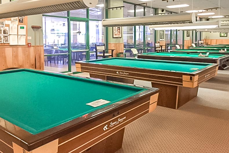 Pool tables in an amenity center at Wynmoor Village in Coconut Creek, Florida