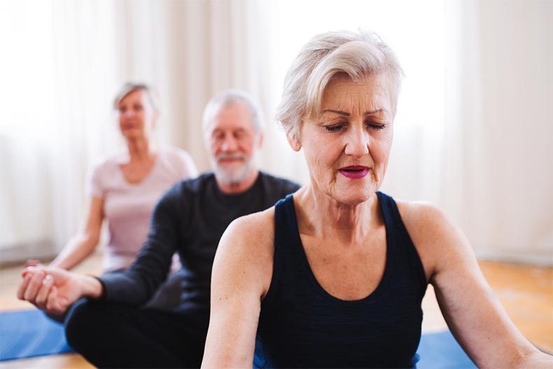 Group of older adults practicing yoga
